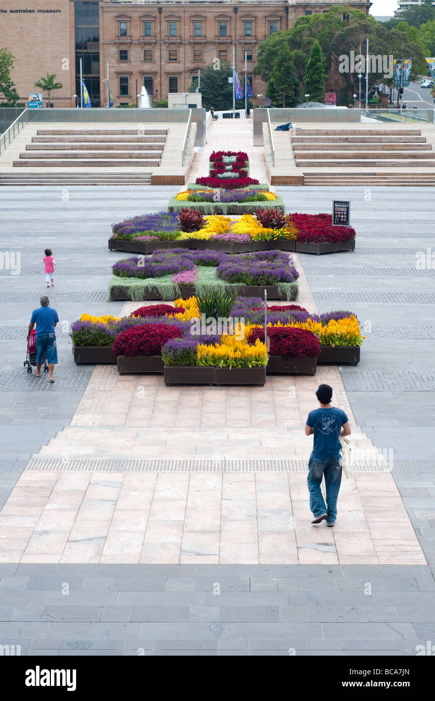 Pedestrianized terrace with flowerbeds in front of St Mary's Cathedral, Sydney NSW Australia - Stock Image