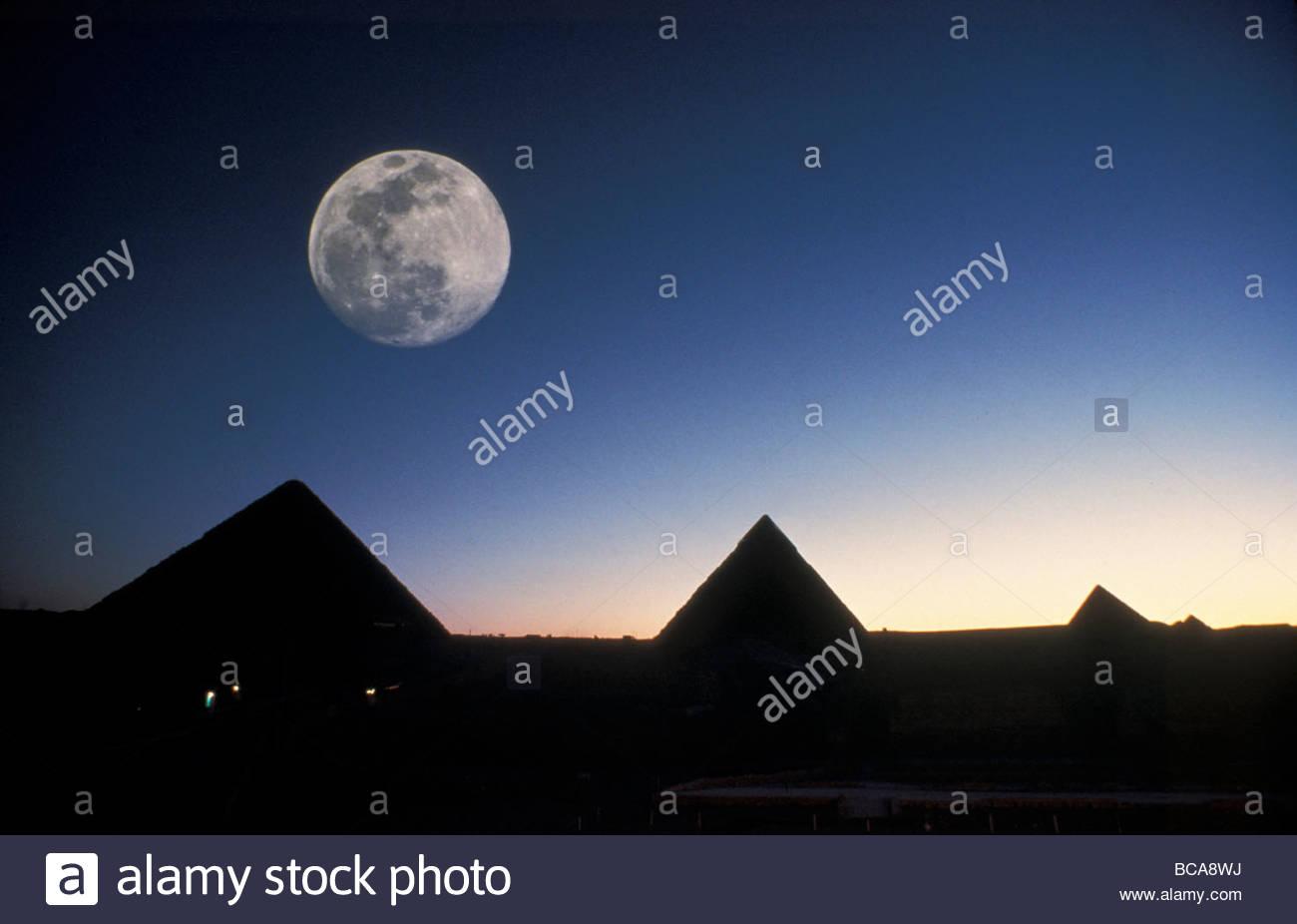 Moonrise above Giza pyramids in Egypt. - Stock Image
