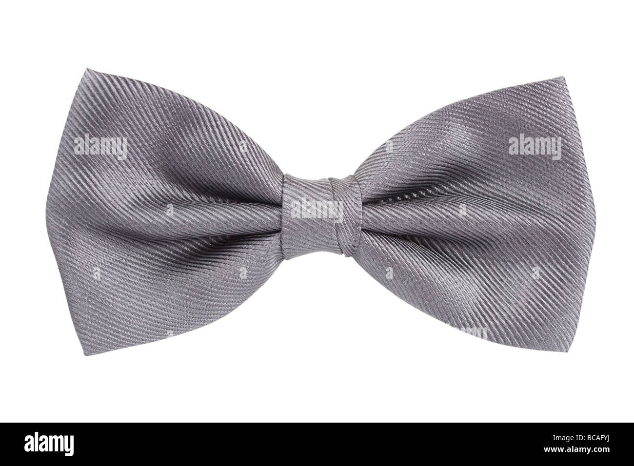 Silver bow tie isolated over white background. - Stock Image