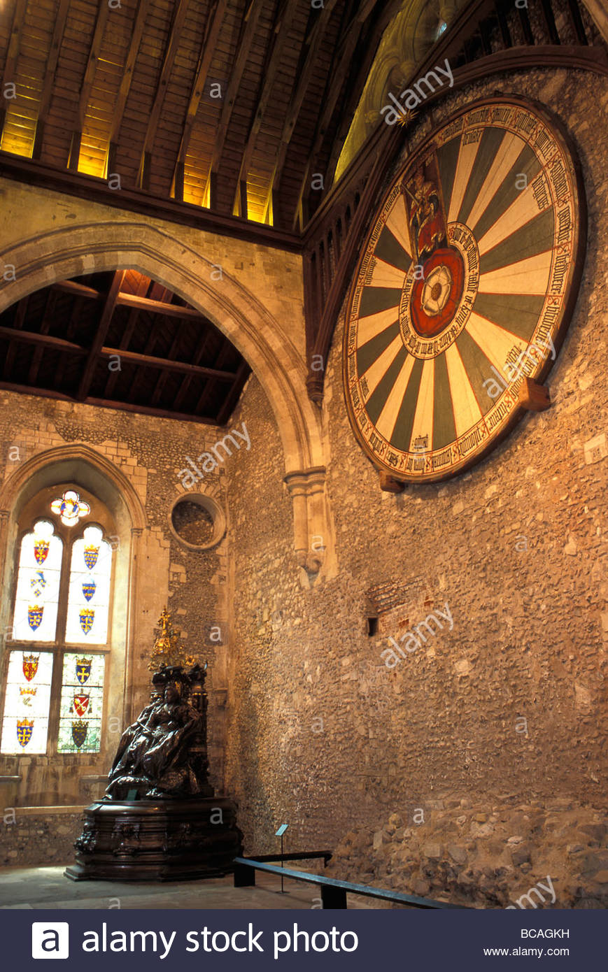 The roundtable, built during King Arthur's reign, hanging  in the Graet Hall in Winchester, England. - Stock Image