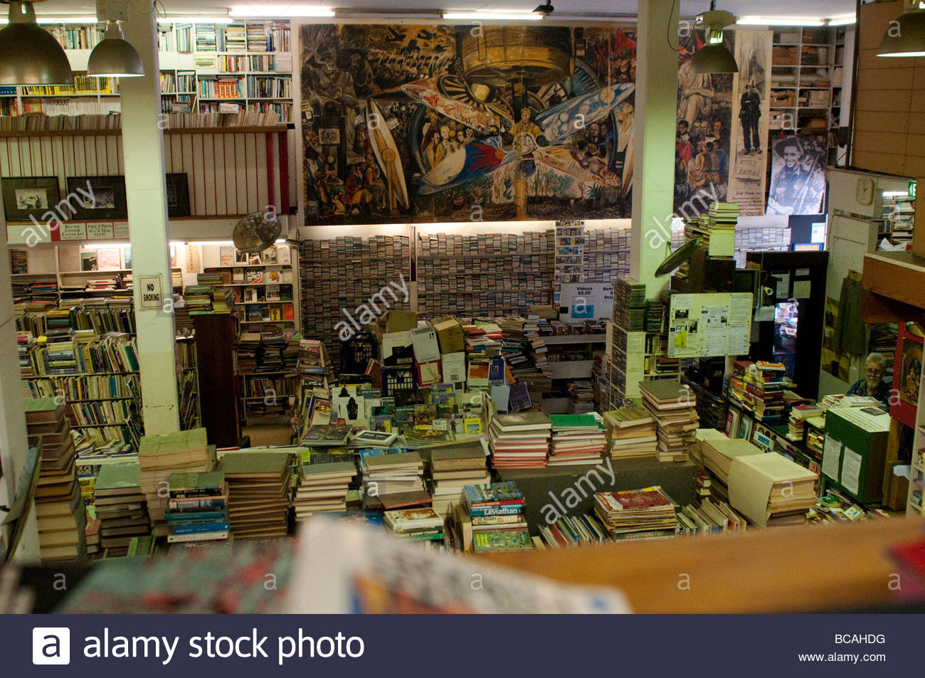 Books in Gould's secondhand bookshop with Diego Rivera poster on King Street, Newtown, Sydney NSW Australia - Stock Image