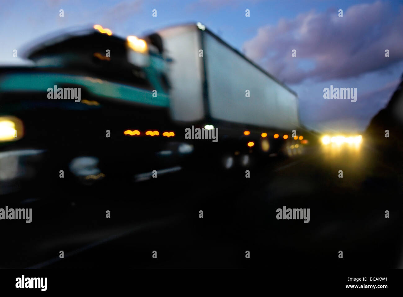 Truck speeding down highway - Stock Image