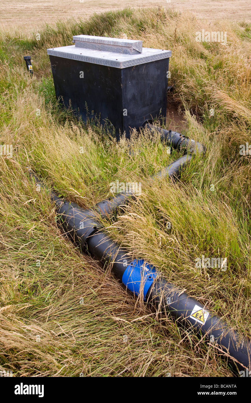 An old rubbish tip on Walney Island in Cumbria where the methane escaping from the decomposing rubbish is being - Stock Image