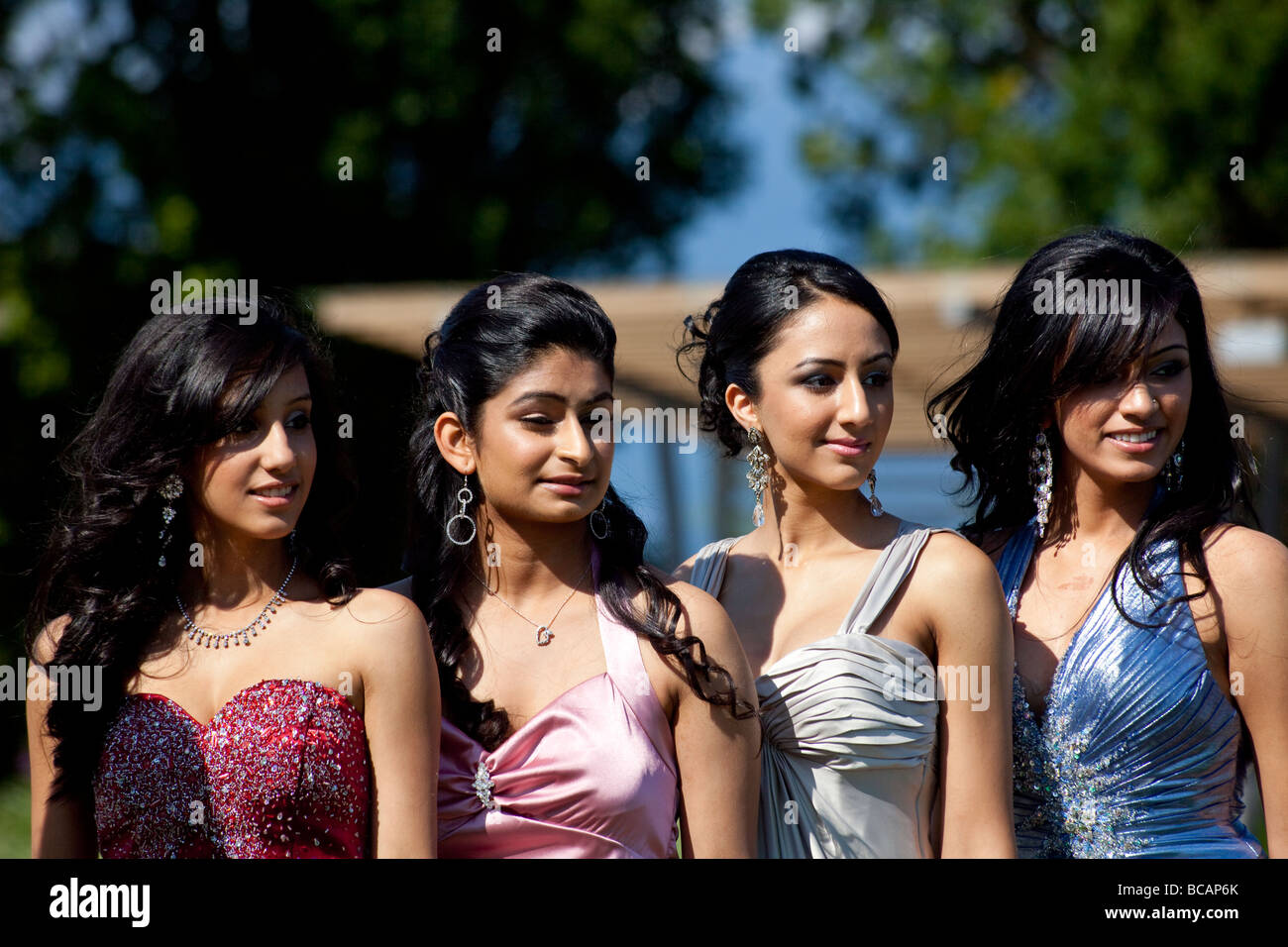 students in formal dress for school prom posing for photographs at ...