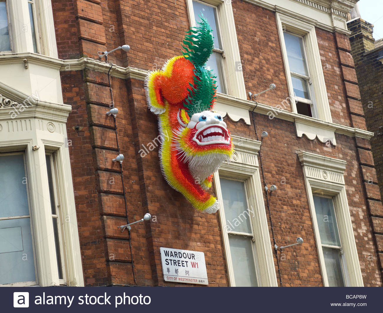 Chinese Dragon on the wall in Wardour Street in China Town in London - Stock Image