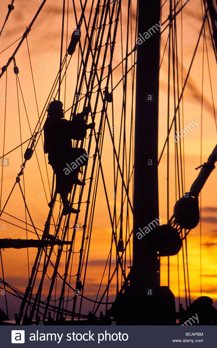 A reenactors climbs up a reconstructed seventeenth centory ship in Jamestwon Settlement, Virginia. - Stock Image