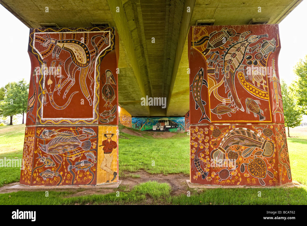 Outdoor art works painted on pylons of bridge spanning Lachlan River at Cowra NSW Australia - Stock Image