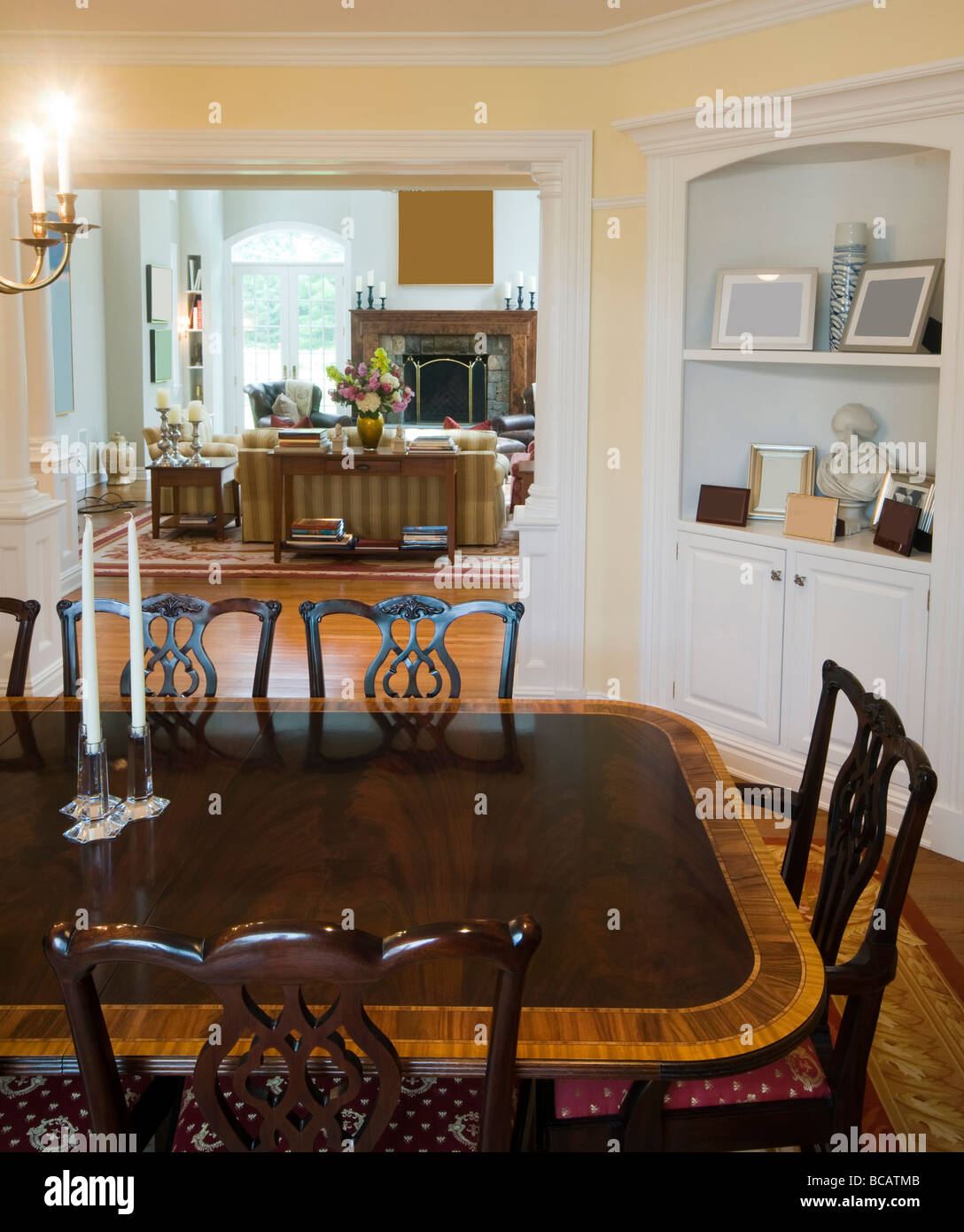 Formal Dining Room With View Of Large And Luxurious Living Fireplace Huge Windows In Mansion Residence