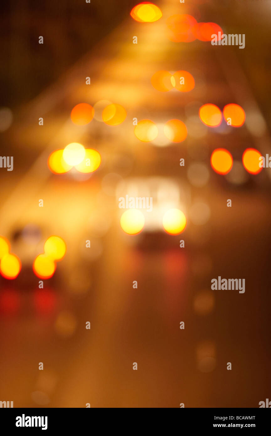 Blurred night freeway traffic - Stock Image