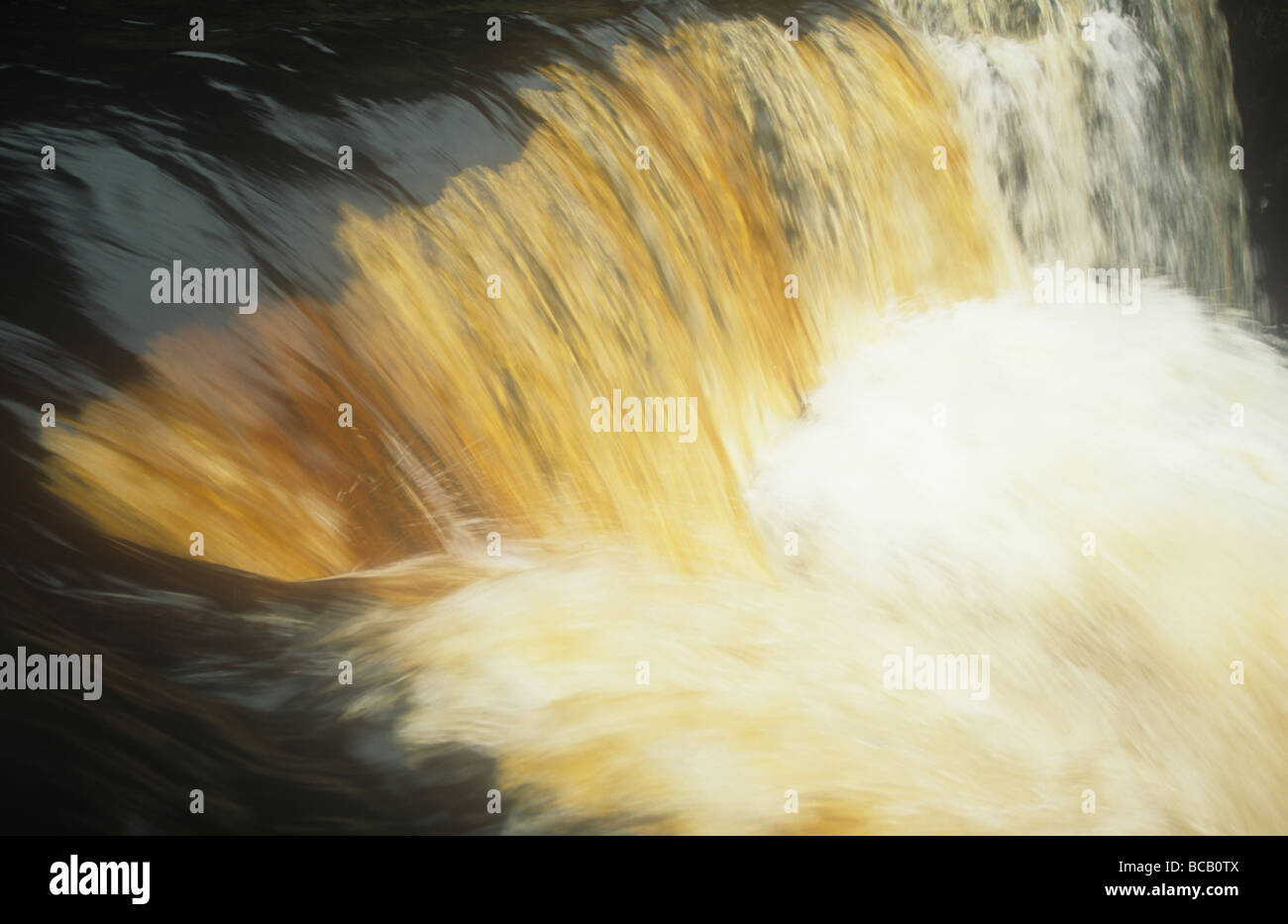 Water stained with peat in Swaledale Yorkshire Dales UK - Stock Image