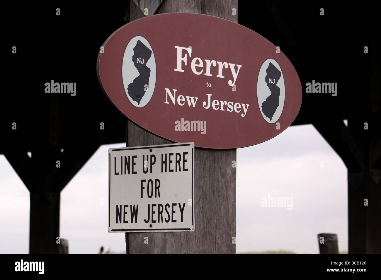 Signage at the Ferry Terminal on Ellis Island - Stock Image
