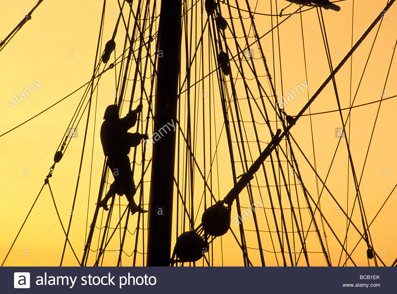 A re-enactors climbs up a reconstructed seventeenth century ship in Jamestown Settlement, Virginia. - Stock Image