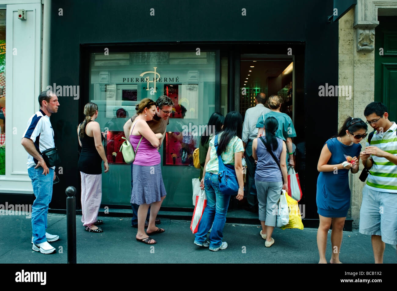 Paris France, French Pastries, Chocolates Store 'Pierre Hermé' Outside Line of People, Queuing up, - Stock Image