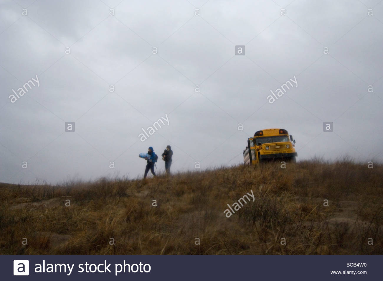 Grouse watchers after spending the rainy morning in a bird blind. - Stock Image