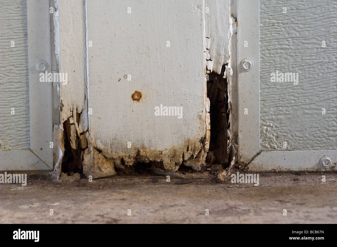 water damaged rotting wooden post - Stock Image