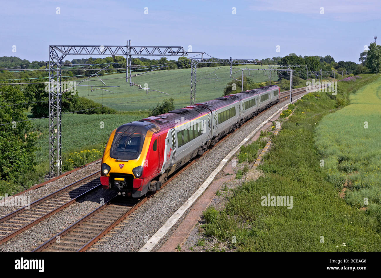 Virgin West Coast Voyager passes Blisworth Northamptonshire with a Euston New Street service on 01 07 09 - Stock Image