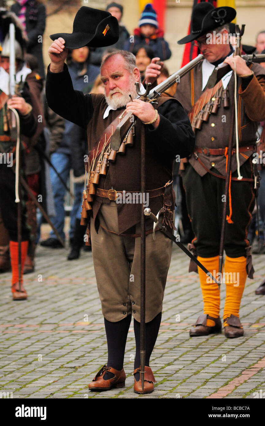 A musketeer raising his hat as a mark of respect in Geneva's annual Escalade Festival - Stock Image