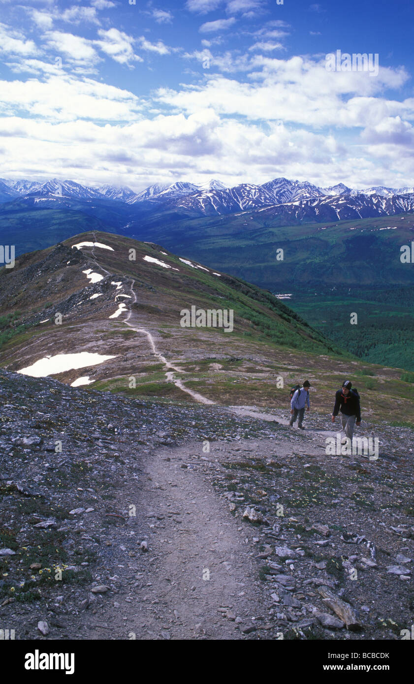 Hikers on Mount Healy Trail. - Stock Image