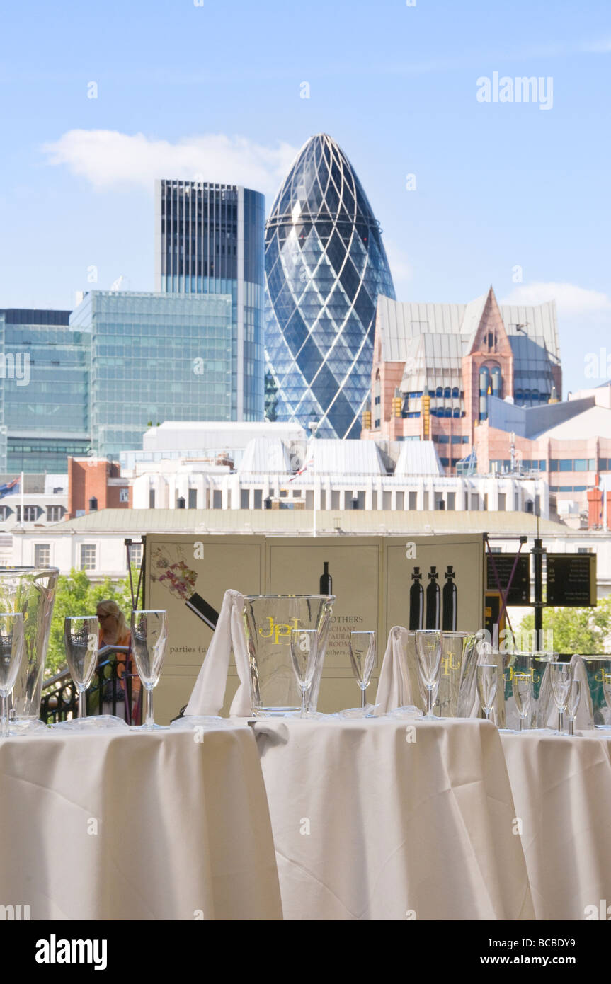 London's banking centre buildings with champagne glasses in the foreground - Stock Image