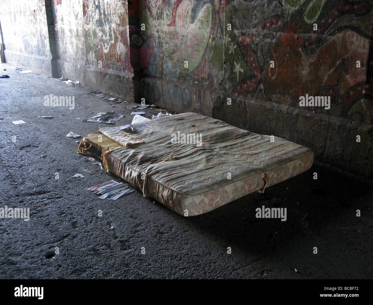 bed of homeless man person under bridge Stock Photo ...