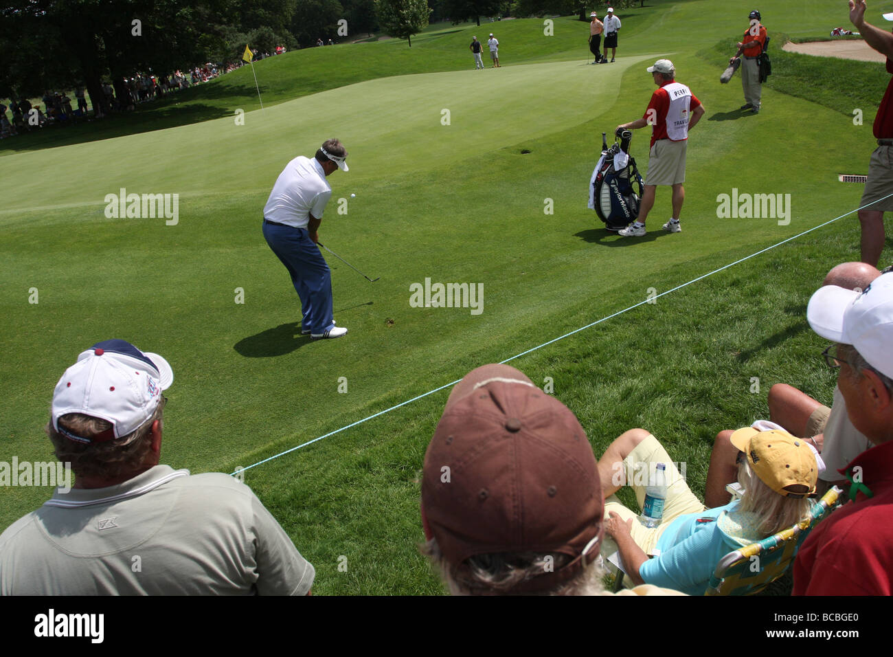 Fans watch a pro golfer during the Travelers Championship golf Tournament in Cromwell CT USA - Stock Image