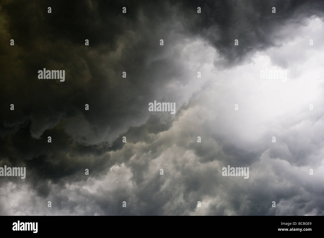Dramatic moody dark storm clouds - Stock Image