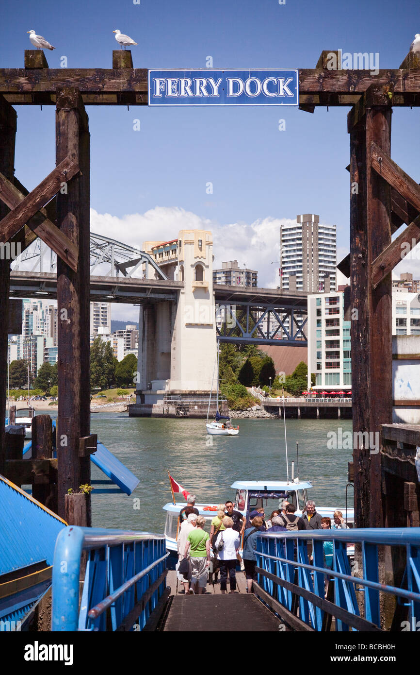 customers boarding sightseeing boat at Granville Island, Vancouver, BC, Canada - Stock Image