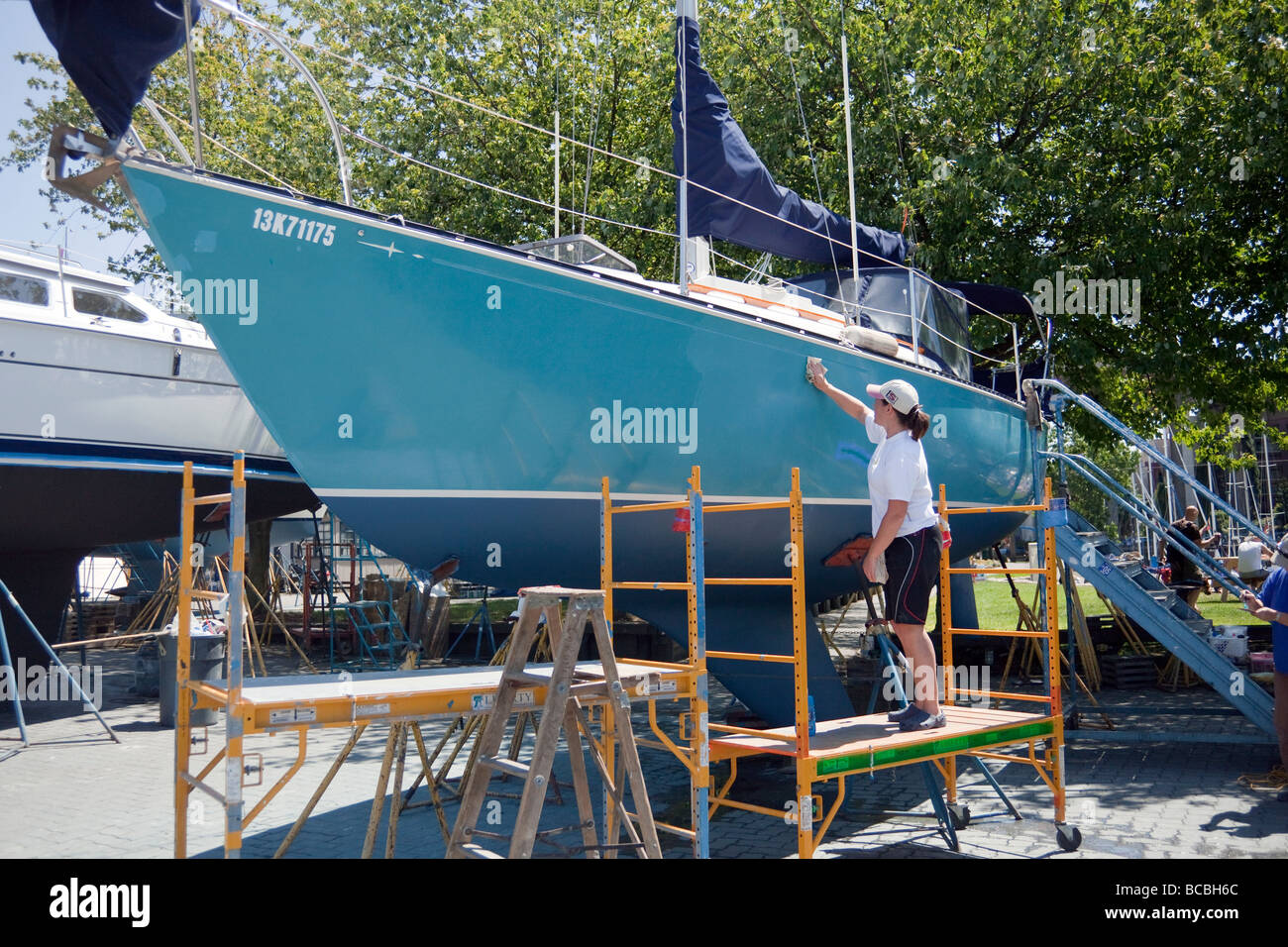 yacht receiving maintenance in Granville Island boatyard, Vancouver, BC, Canada - Stock Image