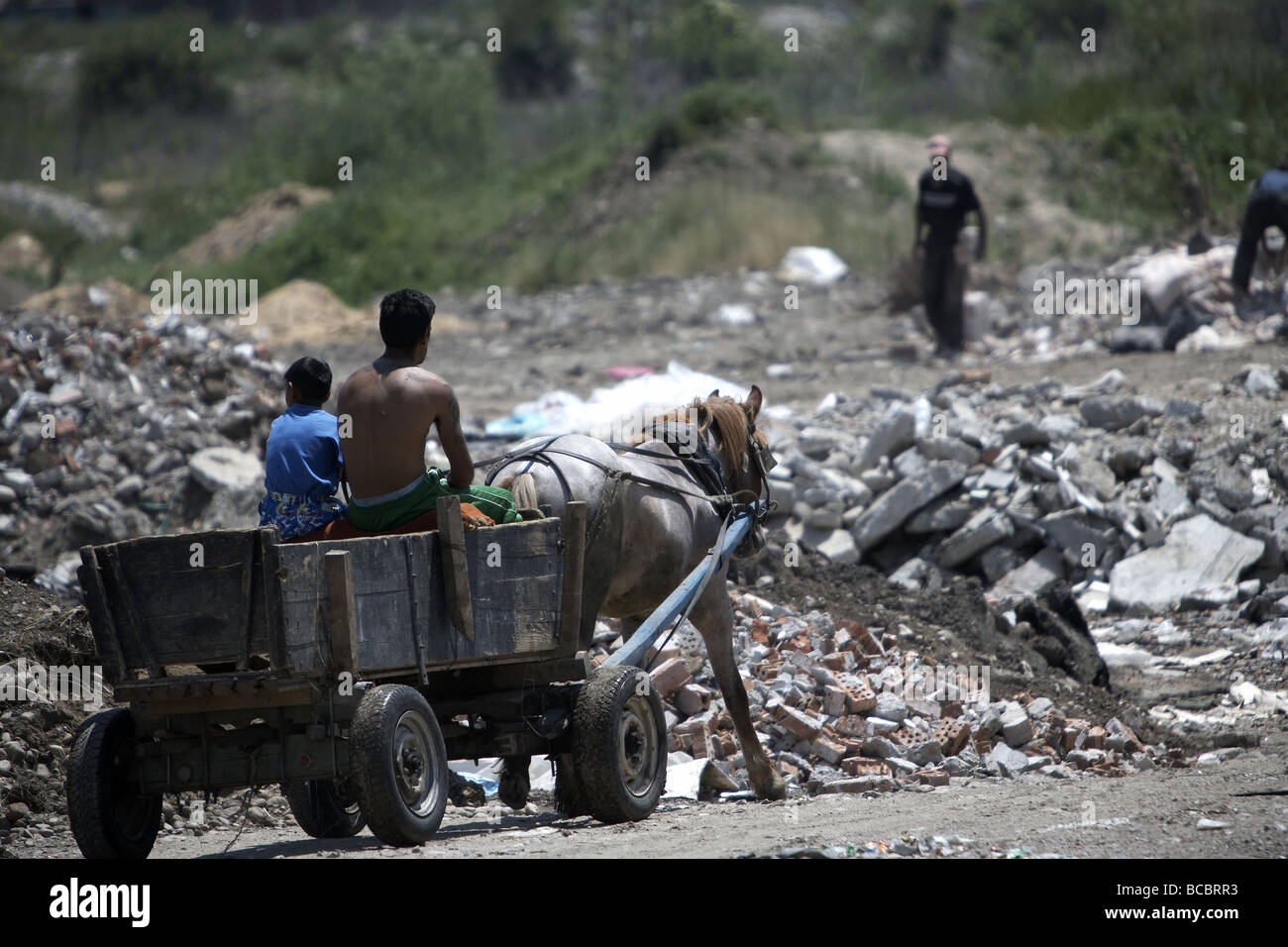 Adults and children scavenging for rubbish using a horse and cart Samokov Bulgaria - Stock Image