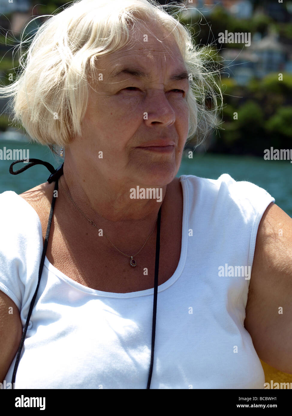 Senior lady in contemplation. - Stock Image