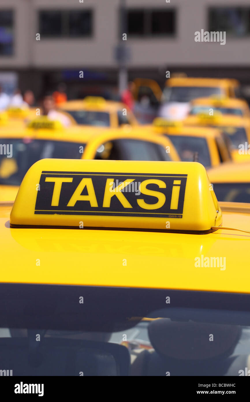 Istanbul Turkey row of yellow taxi cabs taksi lined up in the city centre - Stock Image
