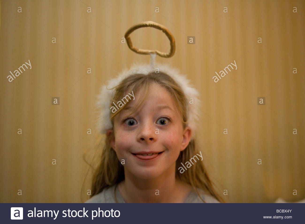 A girl wears a halo in Manhattan, Kansas. - Stock Image
