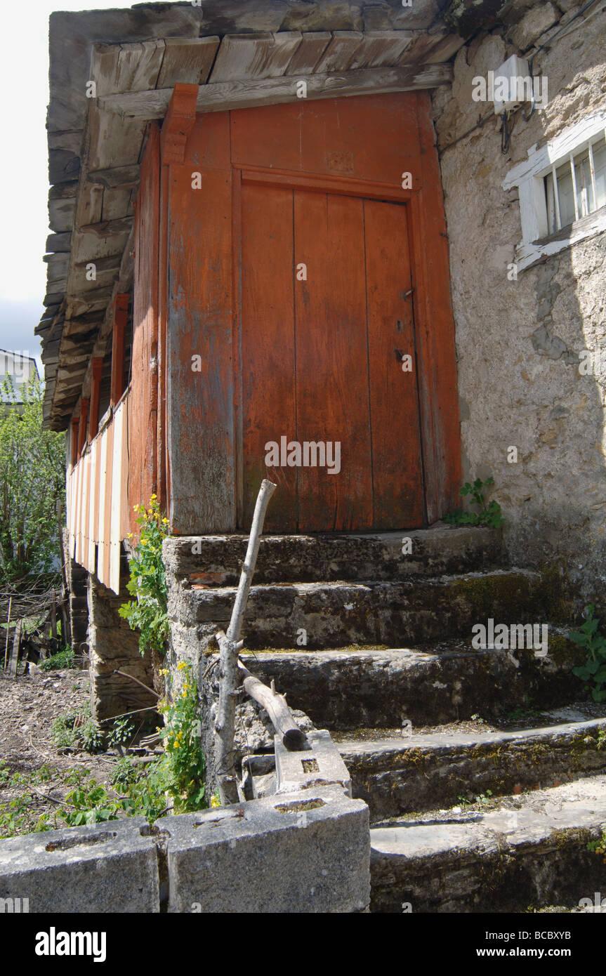 Peeling Orange Paint On Back Door At Country Farm In Spain Stock
