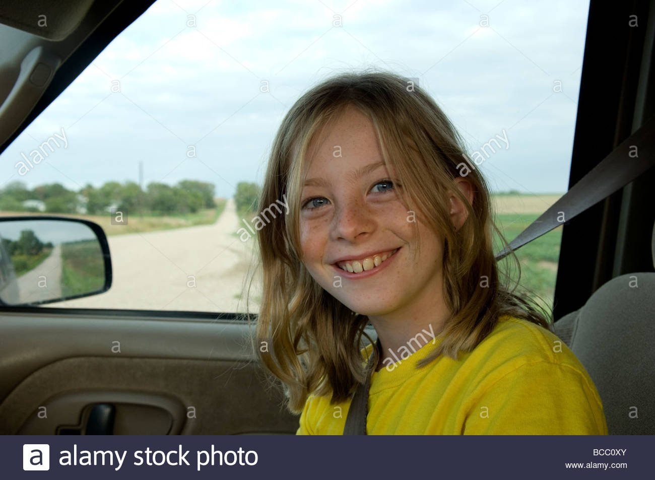 A 10-year-old girl goes for a car ride near Bennet Stock Photo ...