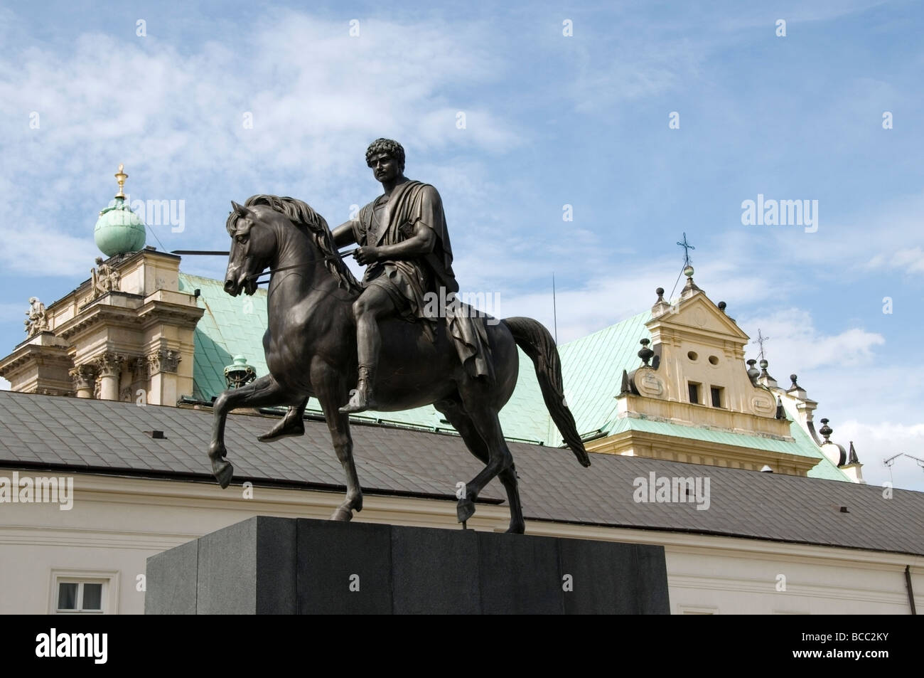 Historical statue of Prince Jozef Poniatowski, equestrian monument and top of Church Carmelite, Warsaw, Poland, - Stock Image