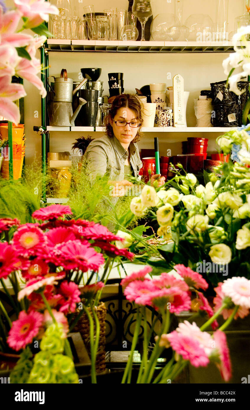 A florist selecting flowers for a bouquet in a french flower shop ...
