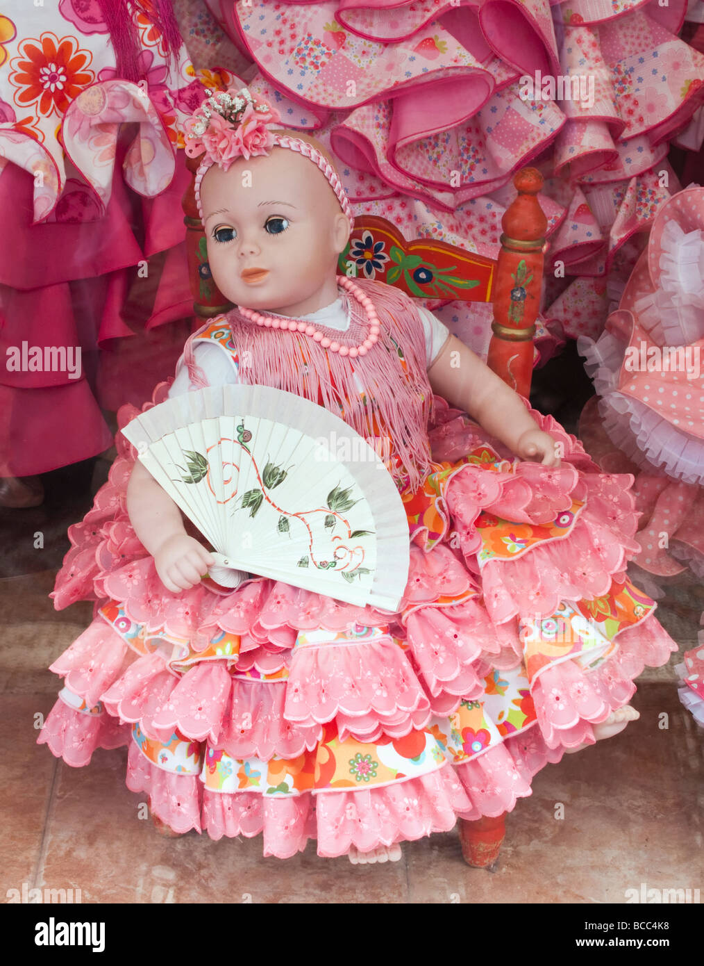 Doll in flamenco dress in shop window Spain Stock Photo