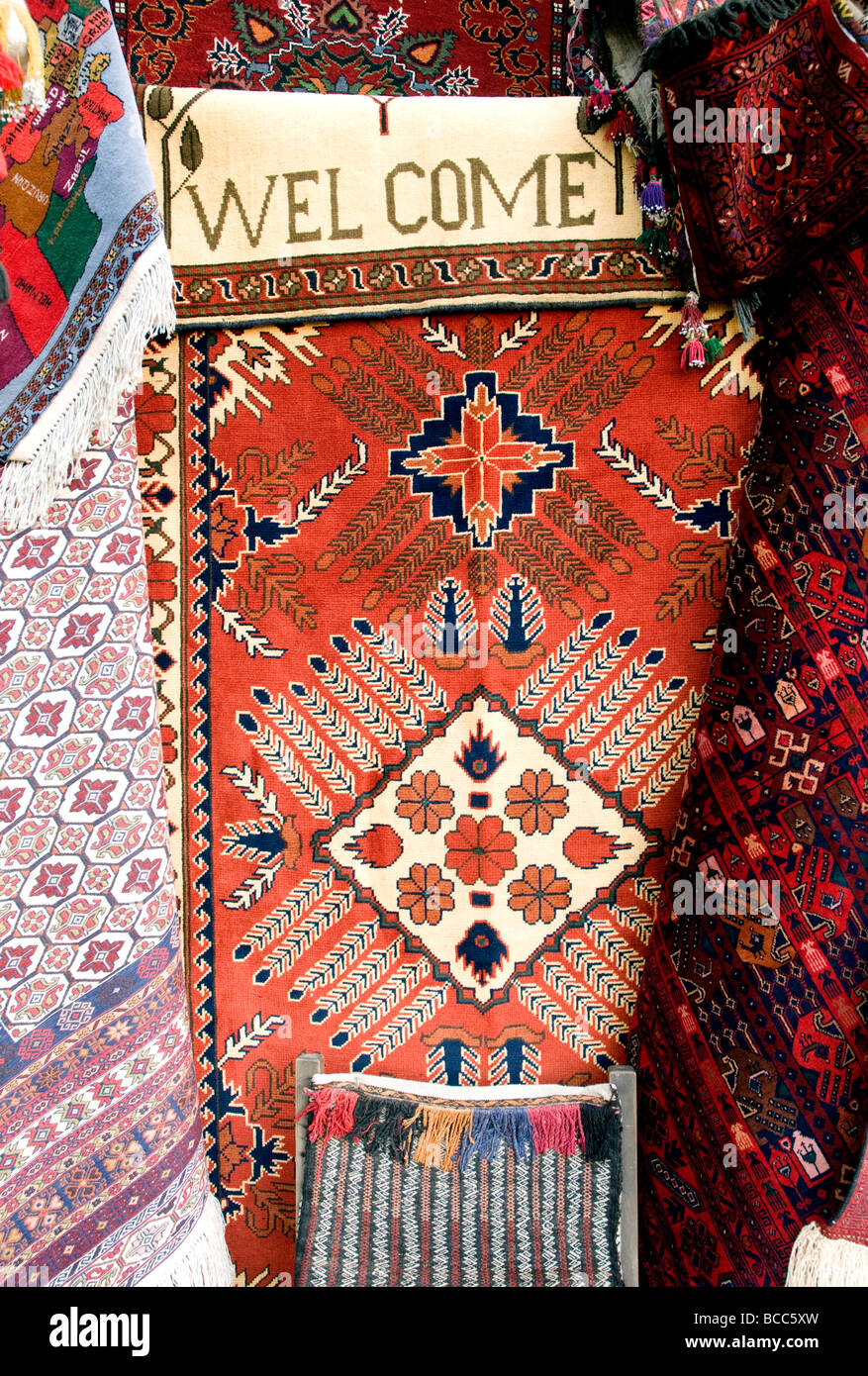 A Welcome motif worked into a carpet in a carpet shop in Kabul; Afghanistan is long renowned for its high quality - Stock Image