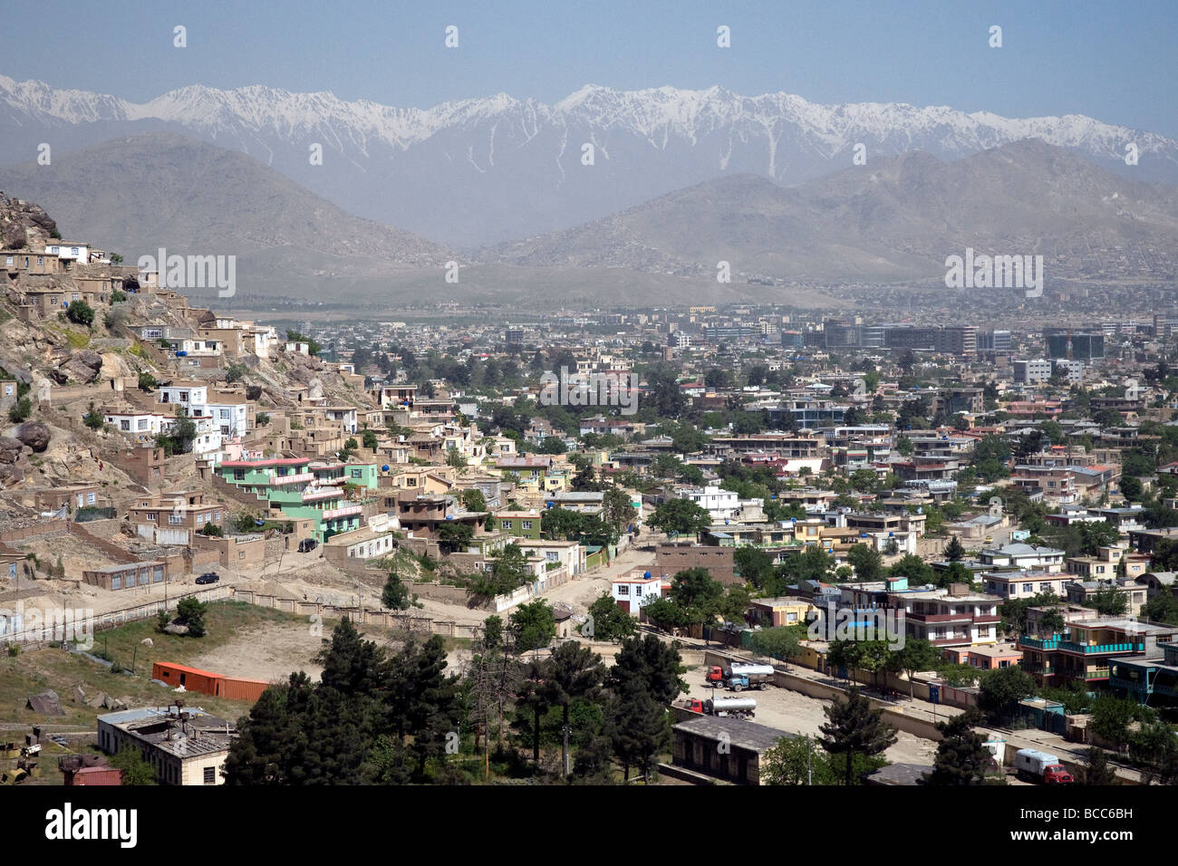 A view of Kabul, Afghanistan, from Koh-e Asmai, popularly called TV mountain, the  snow-covered Koh-i Baba peaks - Stock Image