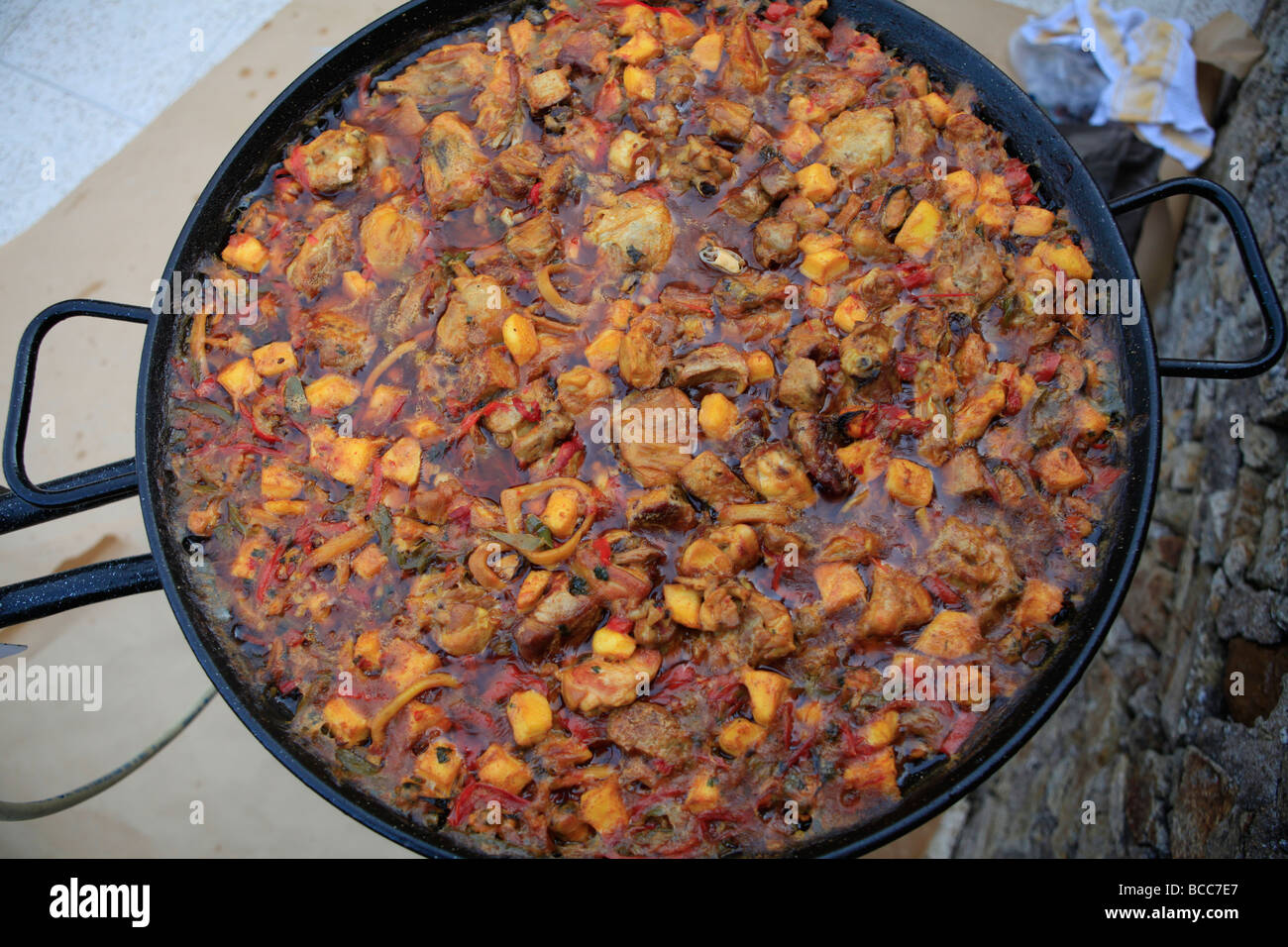 Cooking Paella Spanish Paella probably Spains most colourful and famous gastronomic delight. Spanish food. - Stock Image