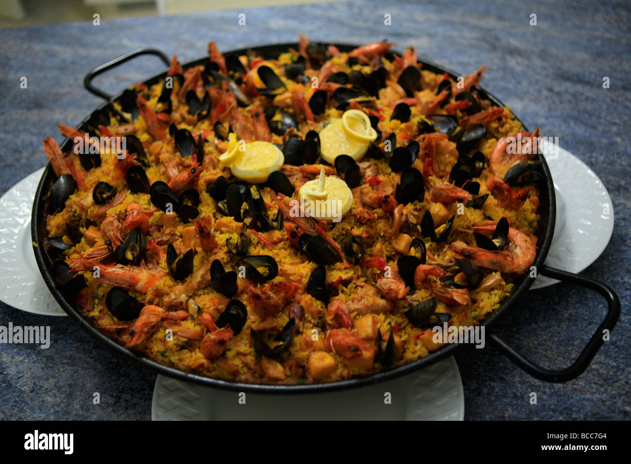 Cooking Paella Spanish Paella probably Spains most colourful and famous gastronomic delight. Spanish food. Stock Photo