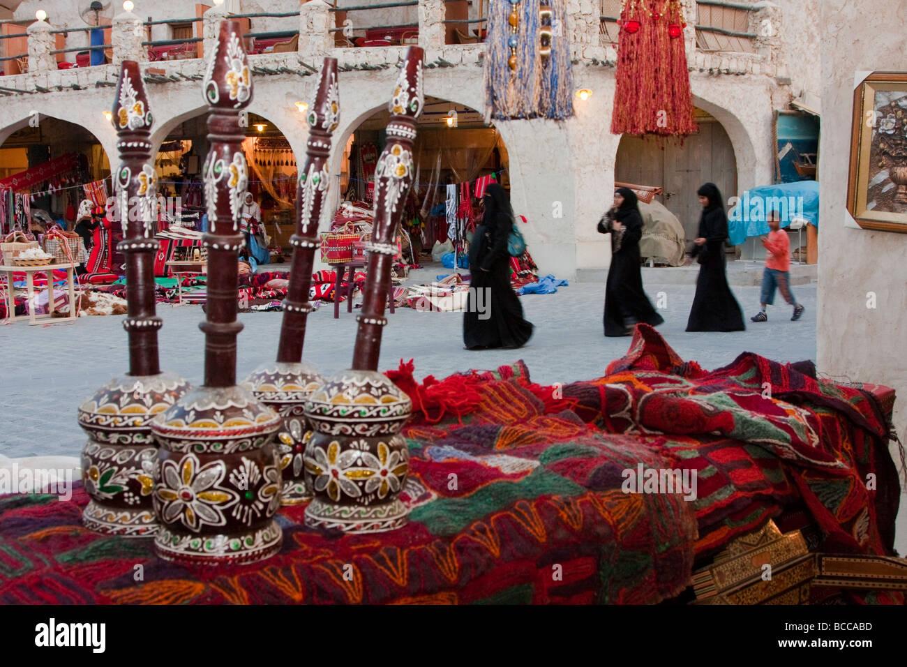 Doha, Qatar.  Market Scene in the Recently Modernized Traditional Market. Qatari Women in Abayas. Stock Photo