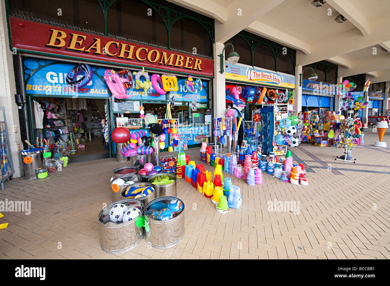 Seaside toys and souvenirs on sale at beach front shops Barry island Wales UK Stock Photo