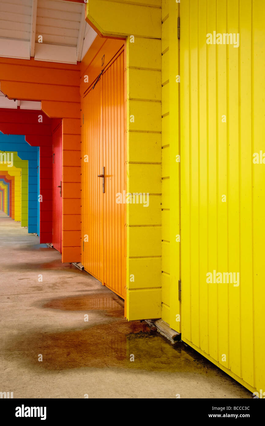 Brightly coloured seaside holiday chalets on the seafront North Bay Scarborough North Yorkshire England UK Europe - Stock Image