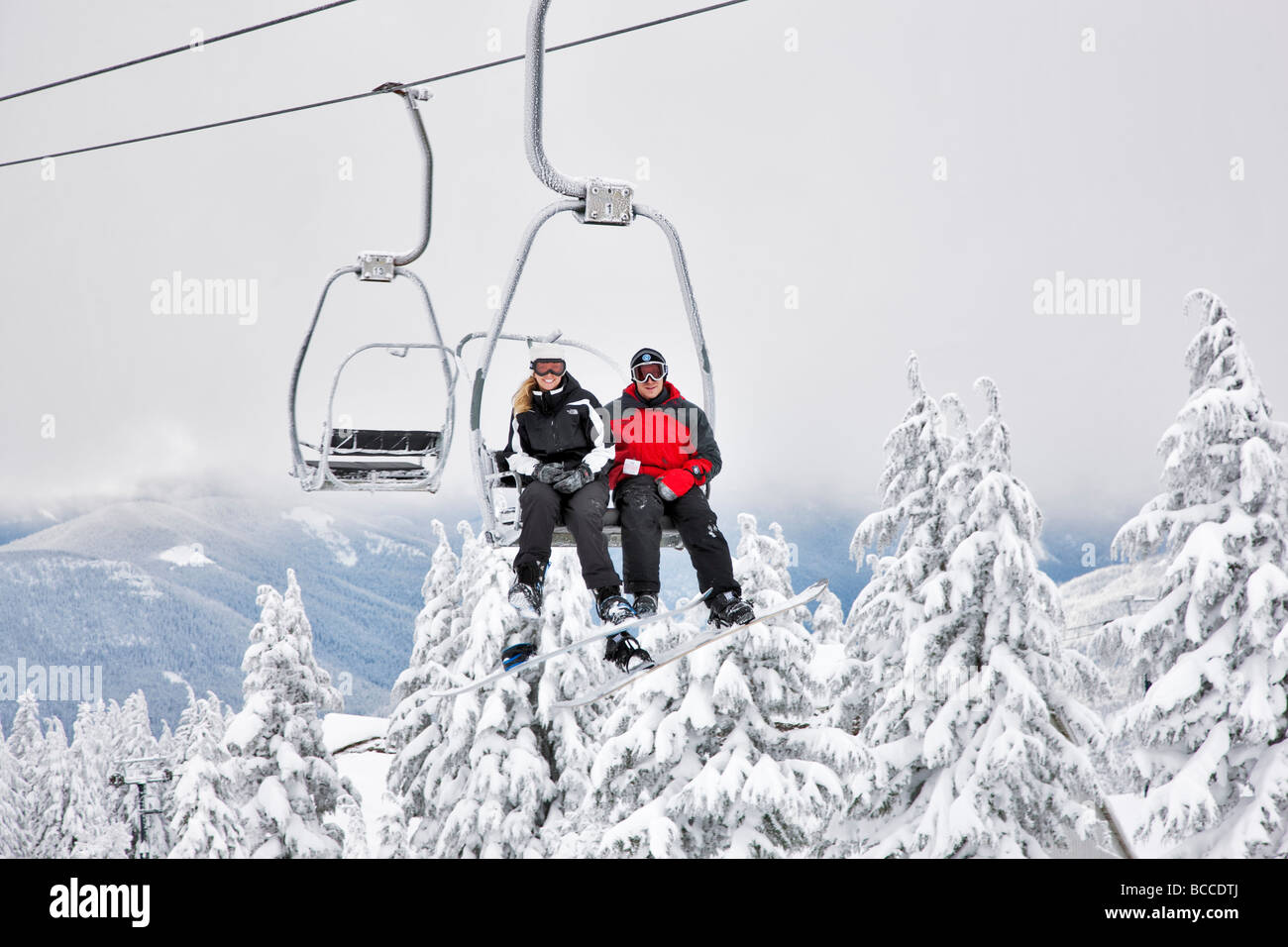 Couple on chairlift Timberline Oregon - Stock Image