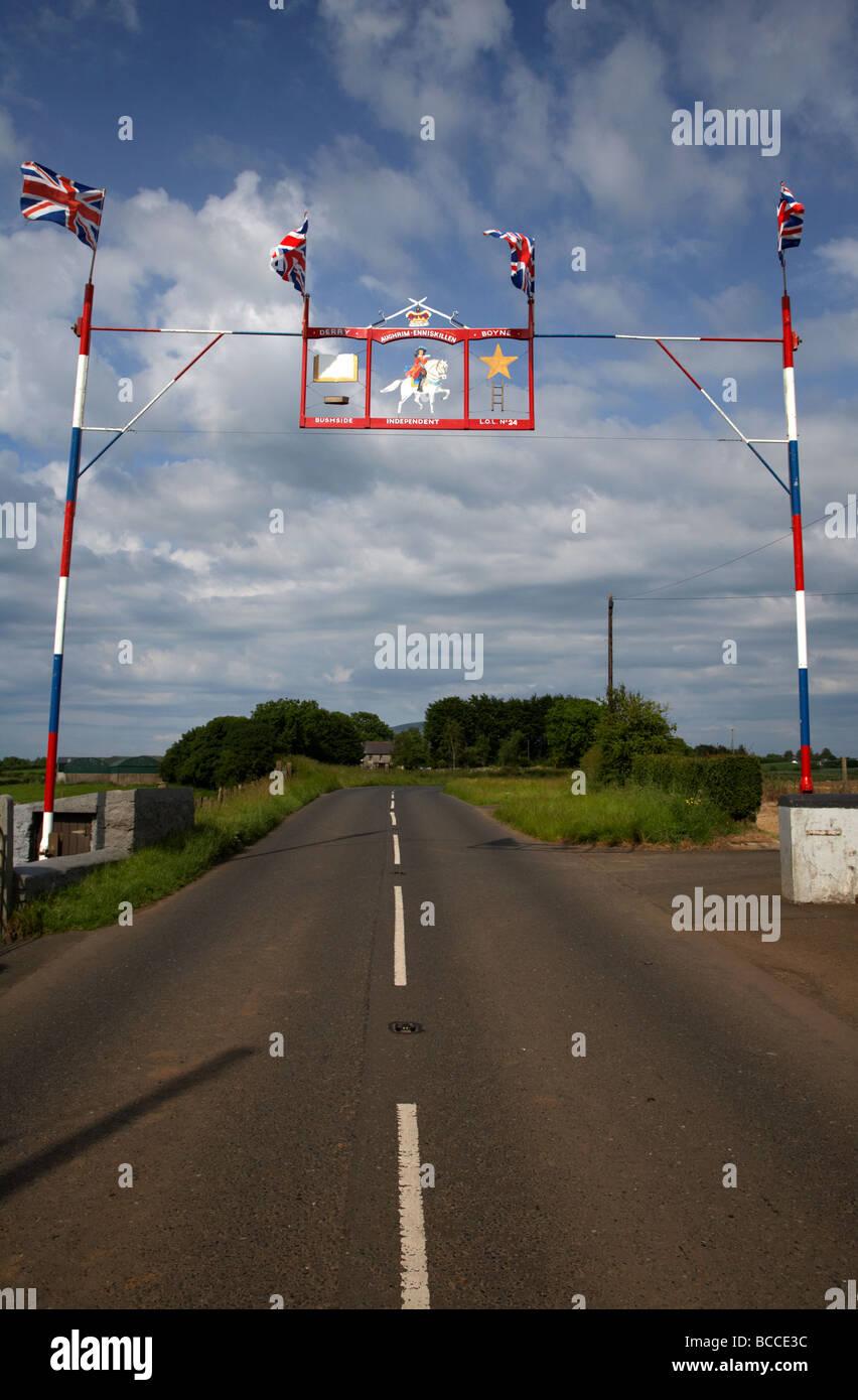 orange order arch across rural county road county antrim northern ireland uk - Stock Image