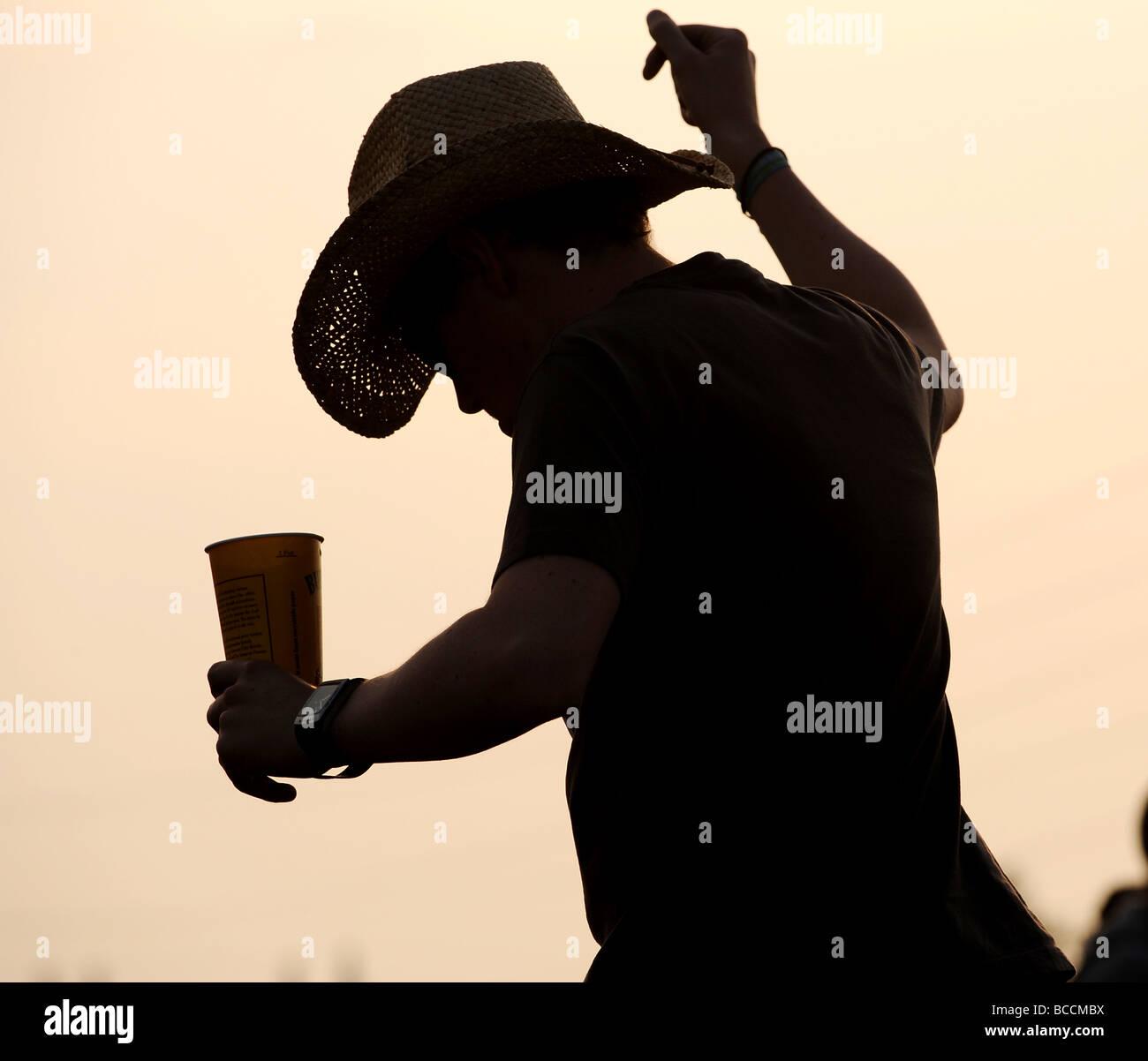reveller at glastonbury - Stock Image
