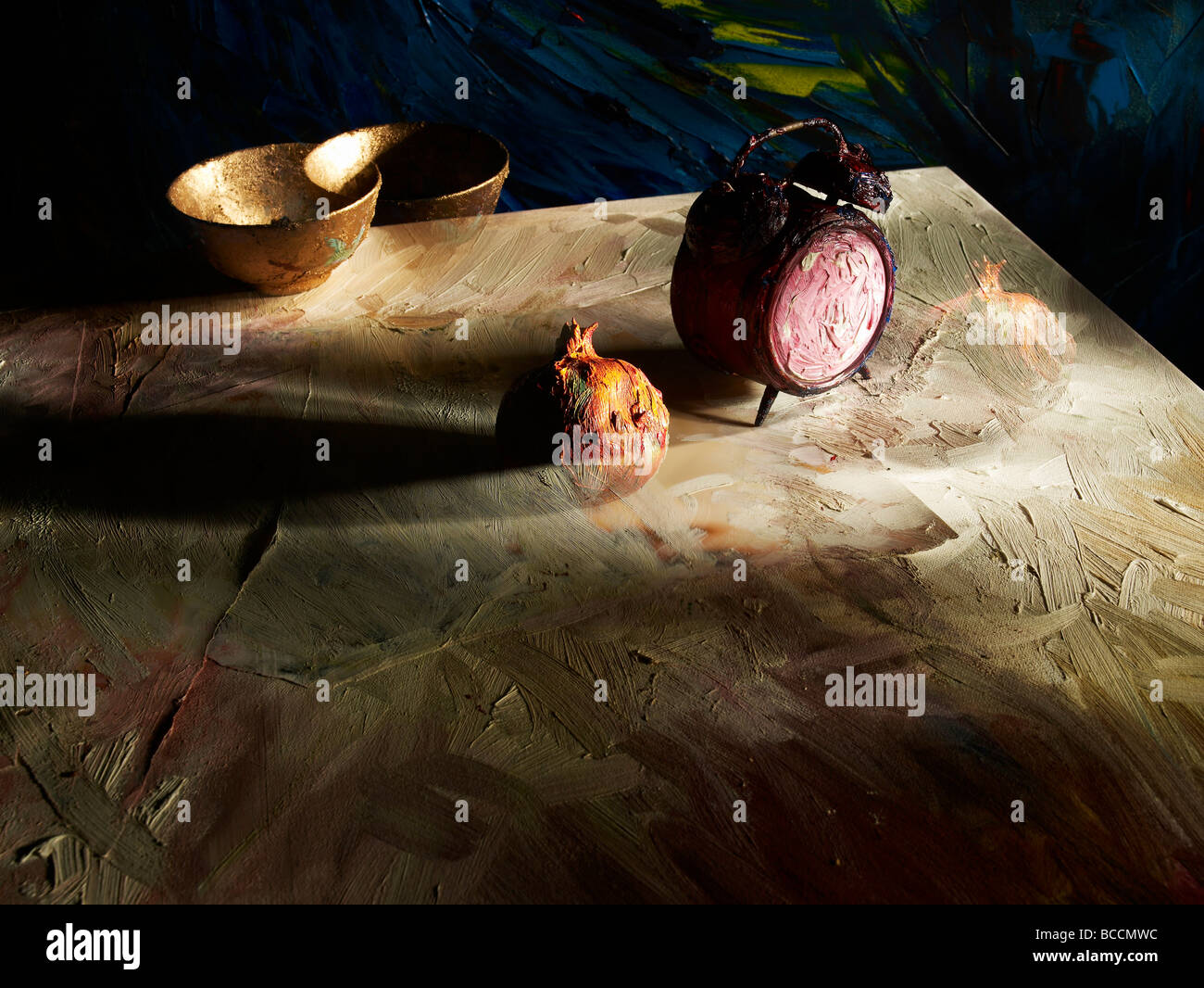 Alarm clock with Pomegrante and golden bowl at the edge of the table in oil painting - Stock Image
