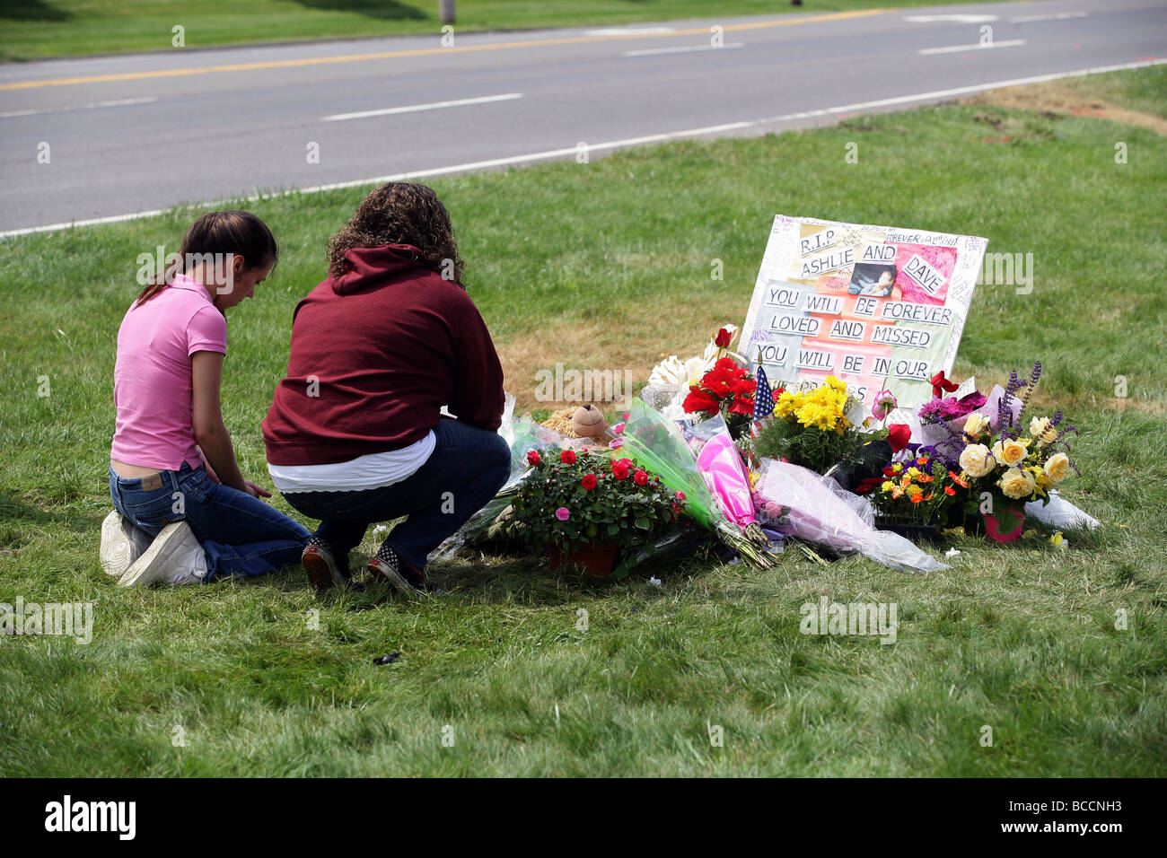 Two Teenage girls cry as they remember two friends killed in a car crash the day before in Orange Connecticut USA - Stock Image