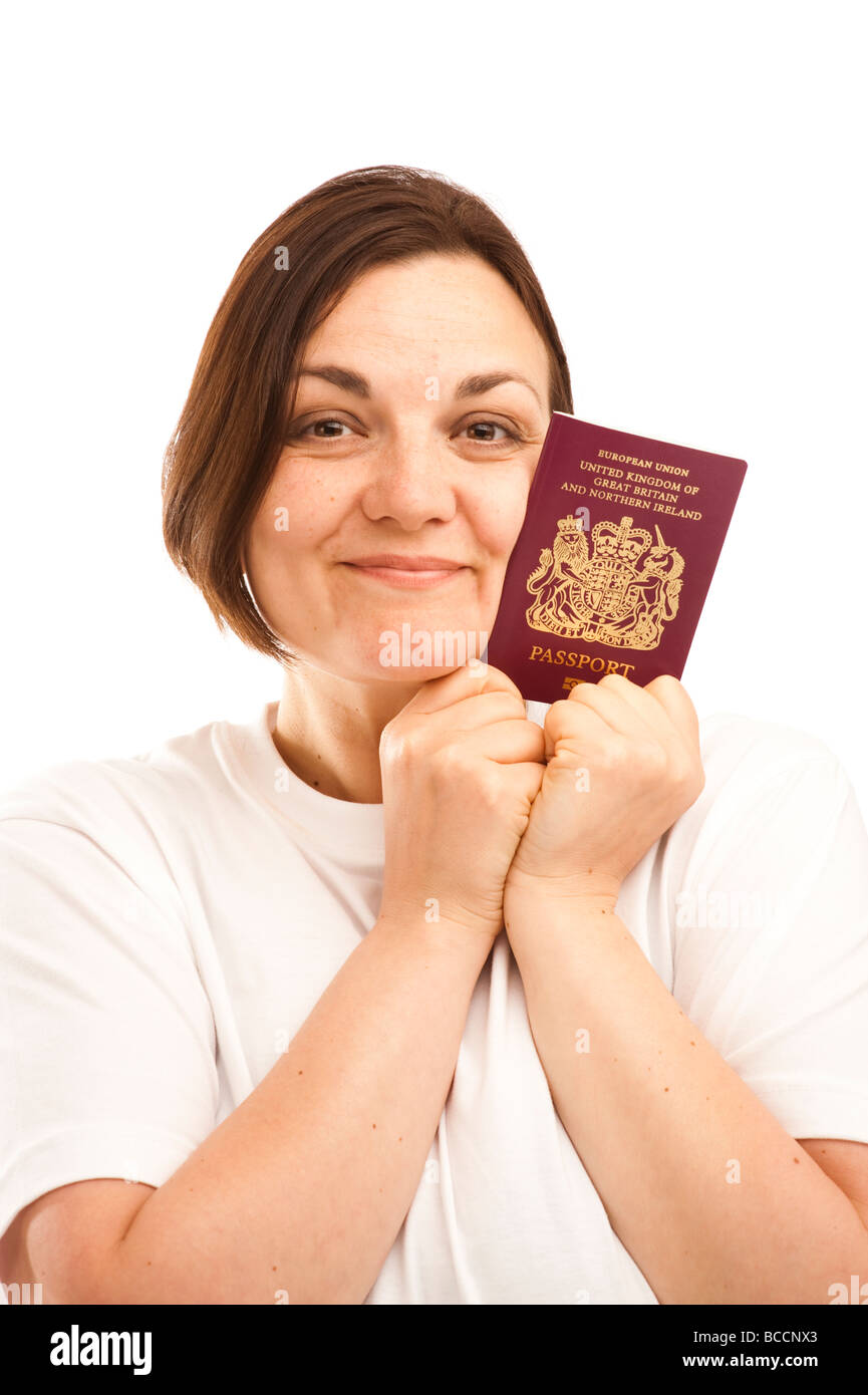 a young british citizen woman holding her UK passport - Stock Image